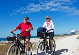 retire-baby-boomer-leisure-exercise-sun-bike-beach-elderly-old-couple