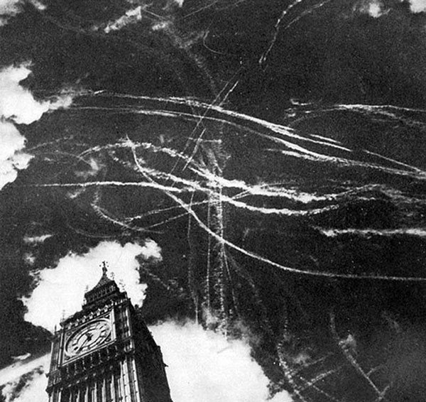 11. The London sky after a bombing and dogfight between British and German planes in 1940