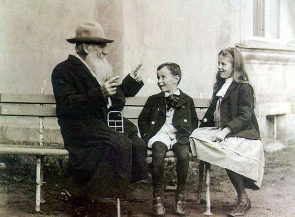 32. Leo Tolstoy telling a story to his grandchildren in 1909