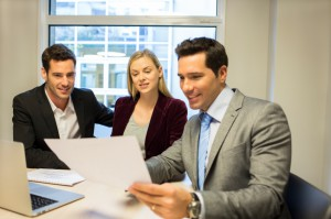 Couple meeting real-estate agent to buy property meeting