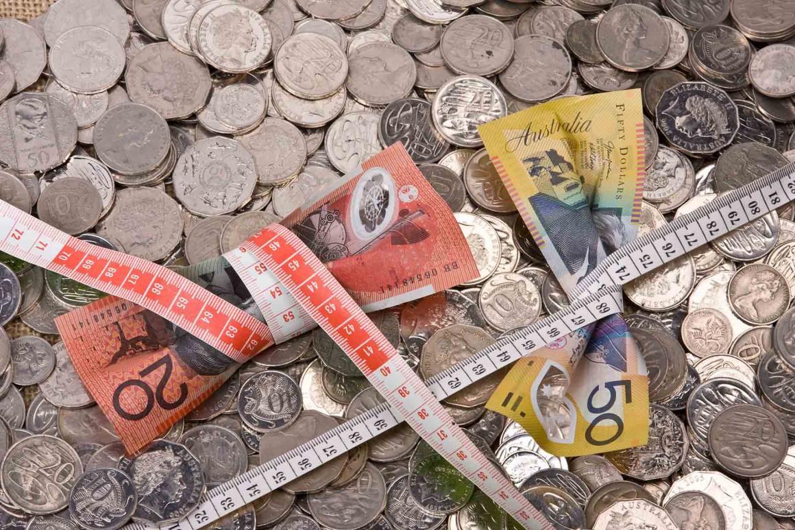 recession-australia-note-money-economy-squeeze-tighten-save-saving-budget-cut