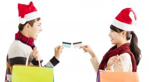 young couple with shopping bags and credit card for christmas