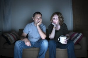 couple watching television bored