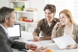 real-estate agent receives a young couple interested to invest i