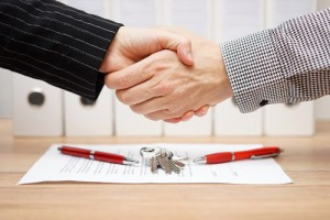 Client And Agent Are Handshaking Over Real Estate Contract