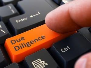 Due Diligence Written On Orange Keyboard Key.