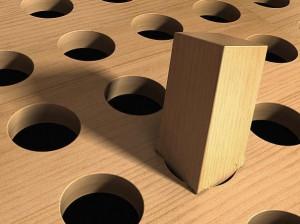 Clavija cuadrada en un agujero redondo
