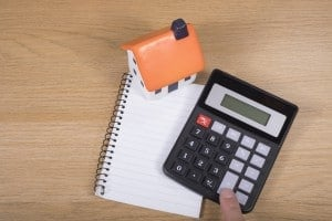 Calculator With Blank Notepad And Model House