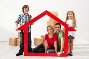 Happy Family With Two Kids Moving Into Their New Home Sitting