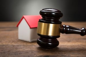 41235969 Close Up Of House Model With Gavel On Wooden Table
