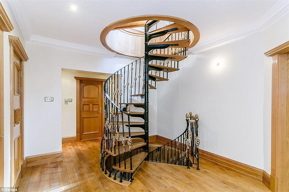 There is an impressive staircase that winds up through the three different levels