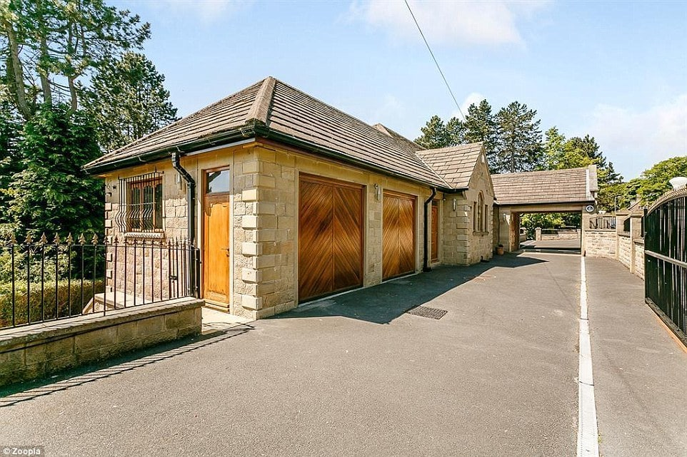 Even within the electric gates at the front, the property resembles a one-storey property - but it drops away to deliver more