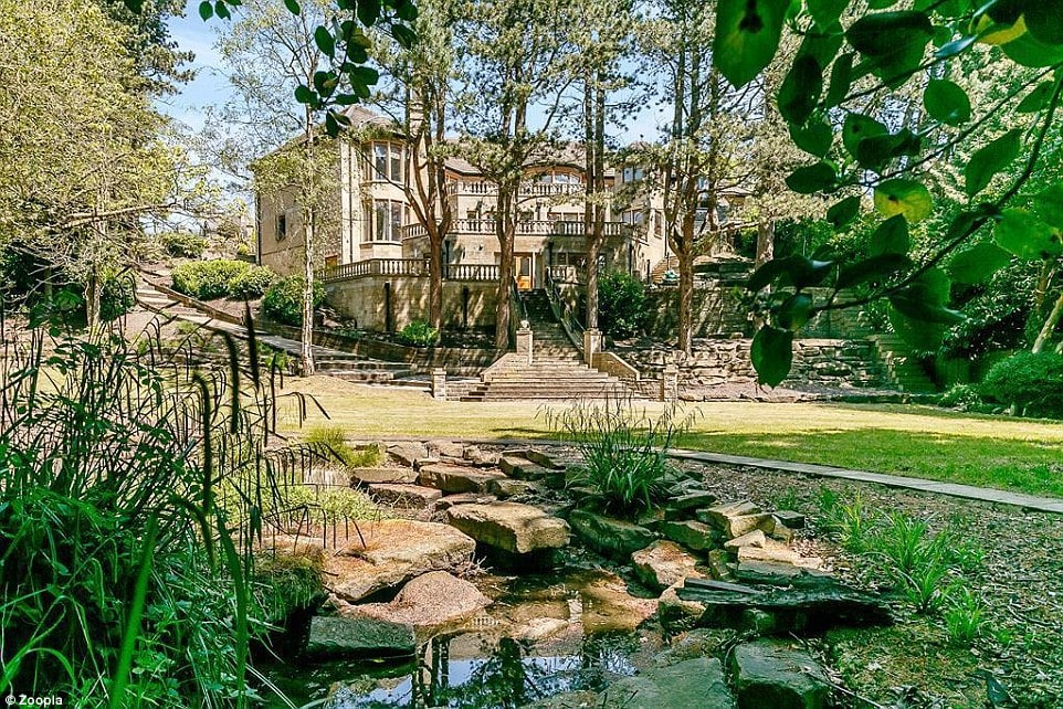The beautifully landscaped gardens include several staircases and a stream