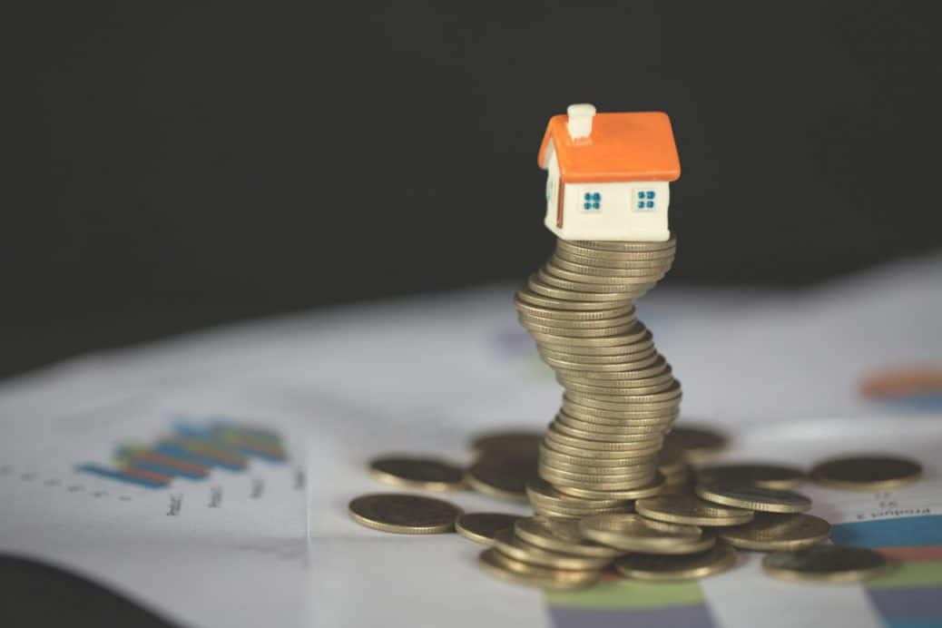 House Model On Top Of Stack Of Money As Growth Of Mortgage Credit, Concept Of Property Management. Invesment And Risk Management.
