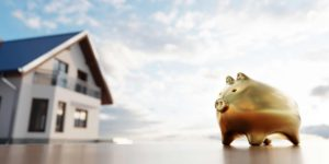 Piggybank And New House Saving For Home Mortgage