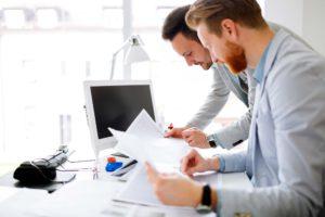 Coworkers Planning Startup Goals Documentsjpg