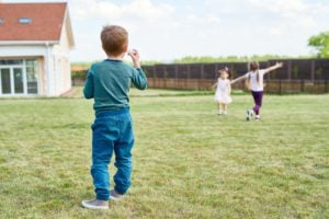 Group Of Children Playing In Front Yard L6z8knr